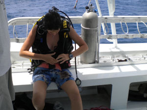 Sarina suiting up for her dive to Aquarius