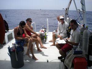 The Expedition team takes a break for a live, at-sea webinar. Note the webcam on Chris' left.