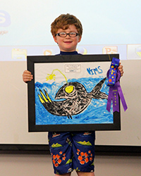 1st grader Johnny Vaughan of Williamsburg won the 2014 Marine Science Day art contest with his colorful anglerfish painting.