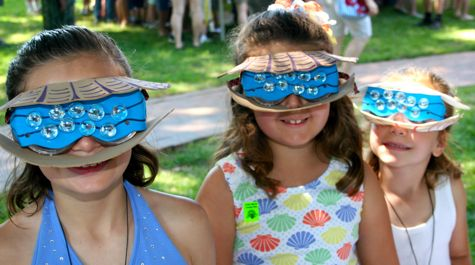 Madeline Allburn, Isabella Weiner, and Clare Allburn dress as scallops on Marine Science Day.