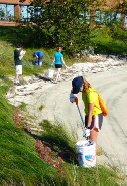 Grad students pick up plastic and other marine litter from VIMS' York River Beach.