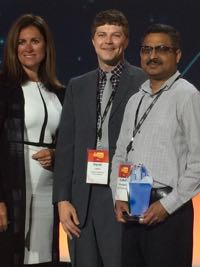 Dr. Derek Loftis of VIMS (C) on stage with Sridhar Katragadda (R; Systems Analyst for City of Virginia Beach) and Kim Majerus (L; Director of State and Local Government Partnerships at Amazon Web Services) during the ceremony announcing winners of the AWS Best Practices Award for 2017.