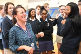 Students congratulate Tami Lunsford on her surprise award. © Milken Family Foundation.