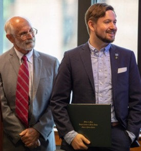 Graduate Chase Long (R) with VIMS Dean and Director John Wells (L) during the VIMS Diploma ceremony. © N. Meyer/W&M.
