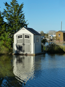 An amphibious shed rises with floodwaters in the VIMS Boat Basin.