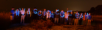 Beach Night participants spell the official hashtag for the festival (#VAScienceFest) using glow sticks. ©Susan Maples Luellen