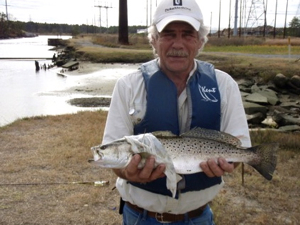 Veteran Dave Conklin with a speckled trout that he caught during a Project Healing Waters outing at the Hot Ditch. Photo courtesy of Susanna Musick.