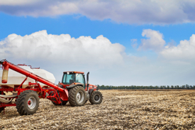 A farmer applies nitrogen fertilizer to a field.
