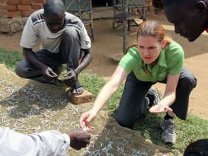 Sarah Glaser and villagers collect dried mukene for analysis at Buluba fishing village. Photo by Cullen Hendrix.