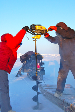Deborah Bronk and a colleague drill through sea ice on the Chuckchi Sea to take water samples.