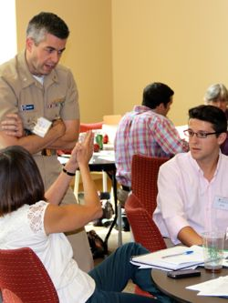 VIMS graduate student Ike Irby (R) discusses flooding issues with fellow conference attendees.