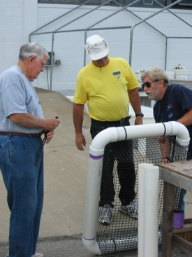 TOGA members Ray Hook, Jim Renner, and Steve Wann learn about constructing a Taylor Float during the training course. Photo courtesy of Vic Spain.