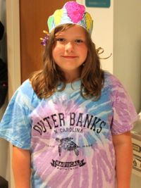 Skyler Chorba of Williamsburg shows off her colorful oyster crown during Marine Science Day. Photo by Erin Kelly.