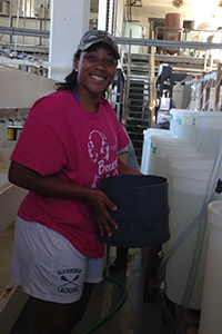 OAT intern Imani Black working inside VIMS' oyster hatchery. Photo: ABC/VIMS