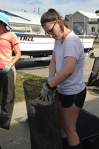 OAT intern Haley Ladeau works outside VIMS' oyster hatchery. Photo: ABC/VIMS