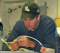 John  Pohlman prepares sampling equipment in a shipboard lab during the study of gas hydrates.