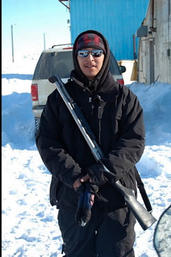An Inupiat native named Roxie helps guard against polar bears.