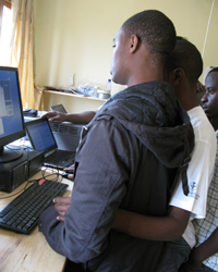 Rwandans help Potter with indoor preparations, instruments, and computer data communication at the Rwanda Climate Observatory.