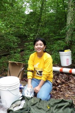 VIMS post-doctoral researcher Yuehan Lu collects field samples from the Chesapeake Bay watershed. Photo courtesy of Sarah Cammer.