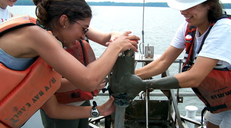 Students extract a sediment core from the floor of Chesapeake Bay.